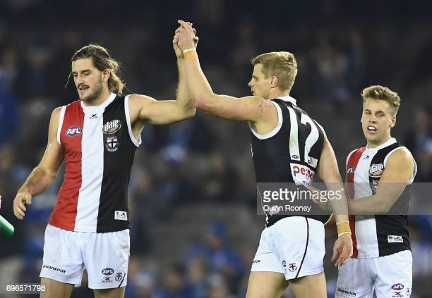 Josh Bruce of the Saints high fives Nick Riewoldt after kicking a goal during the round 13 AFL match between the North Melbourne Kangaroos and the St...