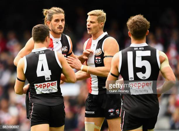 Josh Bruce of the Saints is congratulated by team mates after kicking a goal during the round eight AFL match between the St Kilda Saints and the...