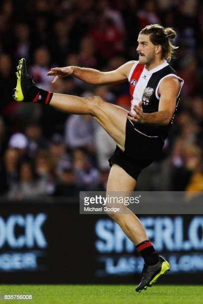 Josh Bruce of the Saints kicks the ball for goal but misses during the round 22 AFL match between the St Kilda Saints and the North Melbourne...