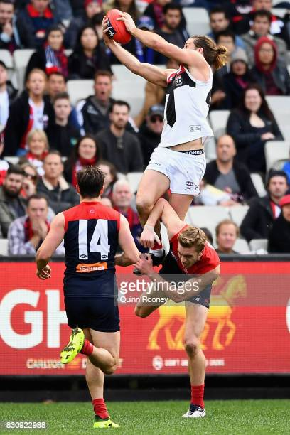 Josh Bruce of the Saints marks over the top of Oscar McDonald of the Demons during the round 21 AFL match between the Melbourne Demons and the St...