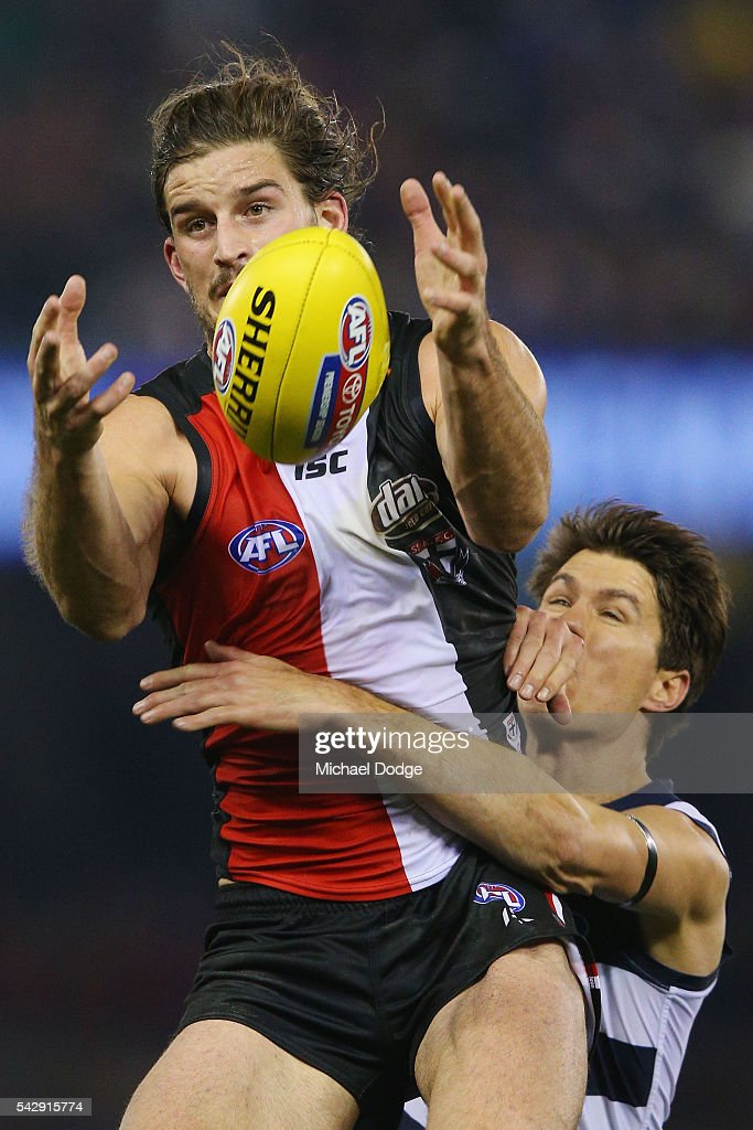 Josh Bruce of the Saints marks the ball against Andrew Mackie of the Cats during the round 14 AFL match between the St Kilda Saints and the Geelong Cats at Etihad Stadium on June 25, 2016 in Melbourne, Australia.
