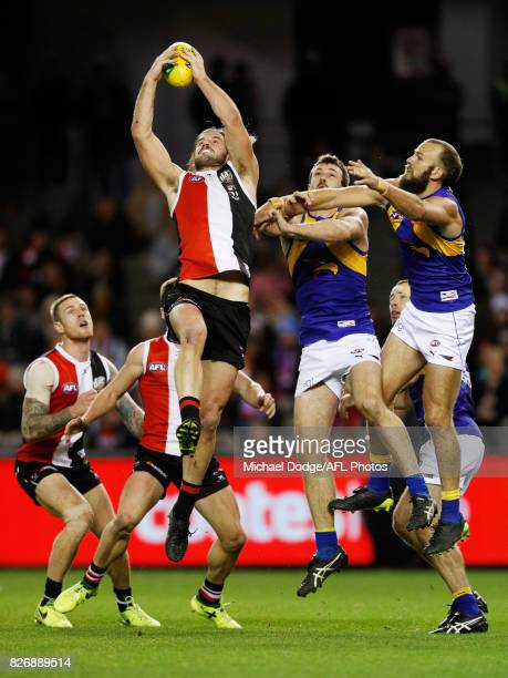 Josh Bruce of the Saints marks the ball against Will Schofield of the Eagles during the round 20 AFL match between the St Kilda Saints and the West...