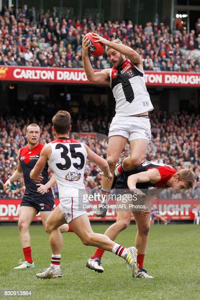 Josh Bruce of the Saints marks the ball during the round 21 AFL match between the Melbourne Demons and the St Kilda Saints at Melbourne Cricket...