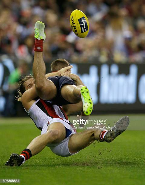 Josh Bruce of the Saints tackles Ben Kennedy of the Demons during the round six AFL match between the Melbourne Demons and the St Kilda Saints at...