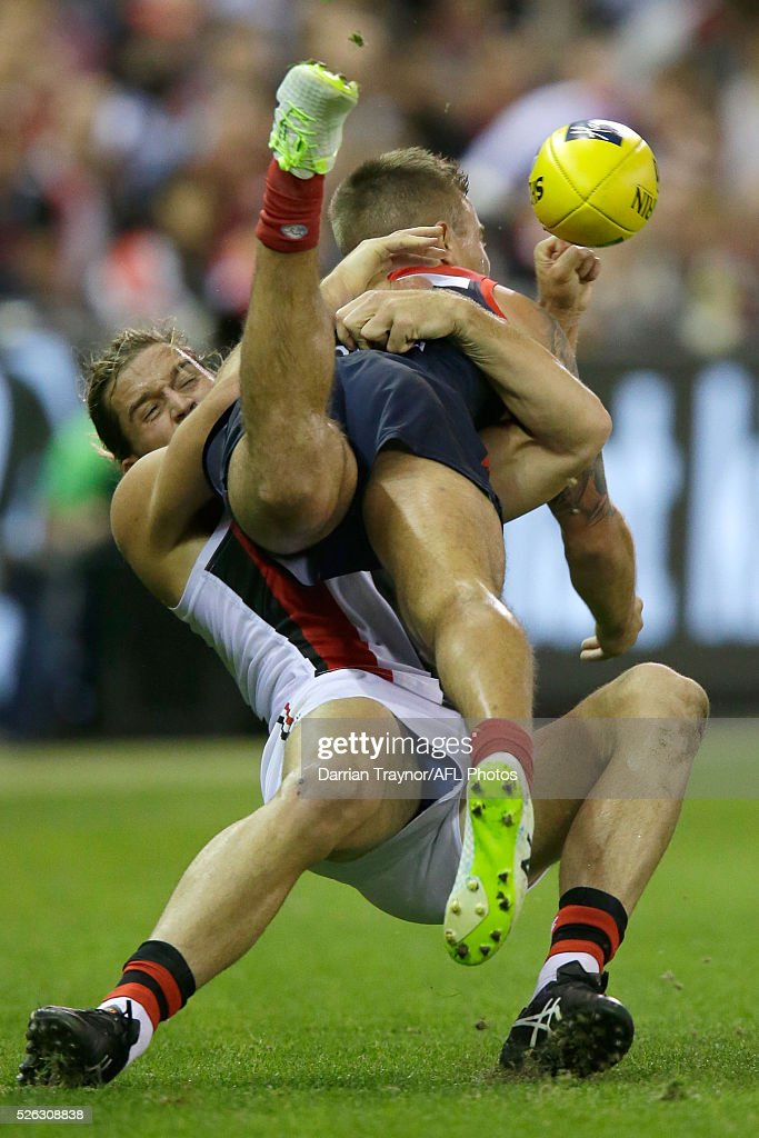 Josh Bruce of the Saints tackles <a gi-track='captionPersonalityLinkClicked' href=/galleries/search?phrase=Ben+Kennedy+-+Joueur+de+football+australien&family=editorial&specificpeople=15138187 ng-click='$event.stopPropagation()'>Ben Kennedy</a> of the Demons during the round six AFL match between the Melbourne Demons and the St Kilda Saints at Etihad Stadium on April 30, 2016 in Melbourne, Australia.