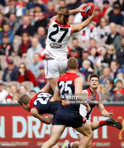 Josh Bruce of the Saints takes a spectacular mark over Oscar McDonald of the Demons during the 2017 AFL round 21 match between the Melbourne Demons...
