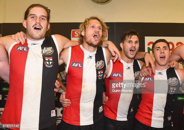 Josh Bruce Sam Gilbert Koby Stevens and Jade Gresham of the Saints sing the song after winning the round seven AFL match between the St Kilda Saints...