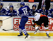 Josh Burnside of the Mississauga Steelheads puts a hit on Matt Luff of the Belleville Bulls during OHL game action on January 16 2015 at the Hershey...