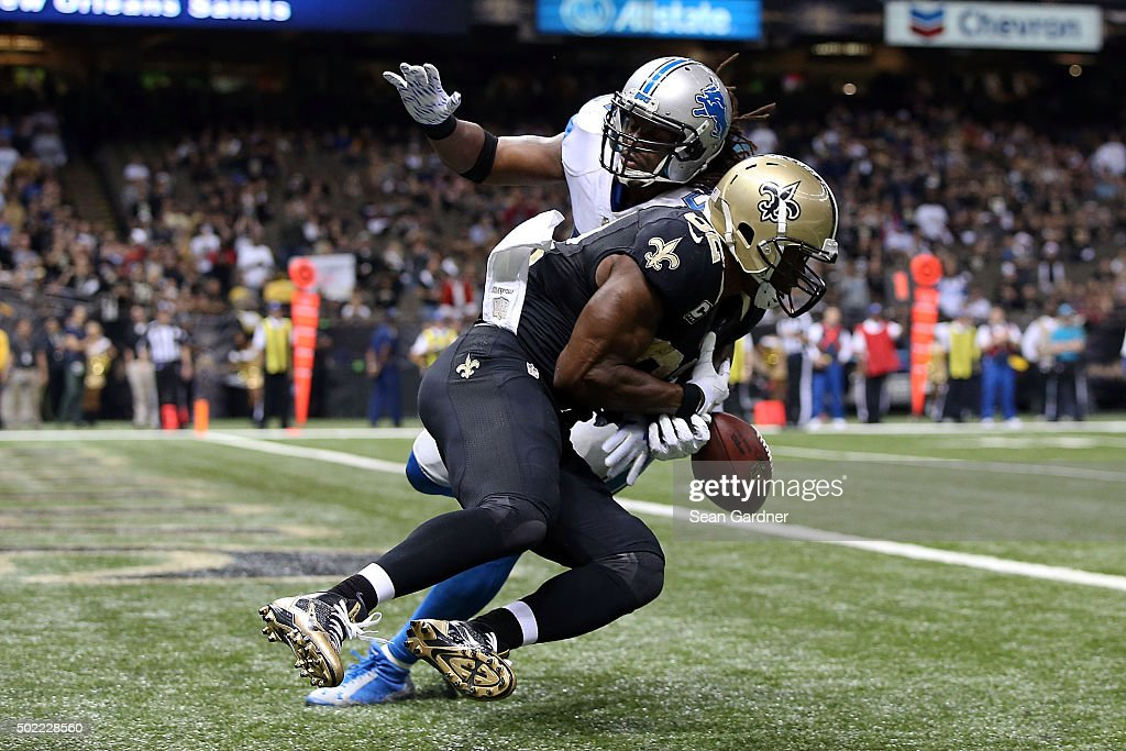 Josh Bynes #57 of the Detroit Lions breaks up a pass intended for Benjamin Watson #82 of the New Orleans Saints during the fourth quarter of a game at the Mercedes-Benz Superdome on December 21, 2015 in New Orleans, Louisiana. Detroit defeated New Orleans 35-27.