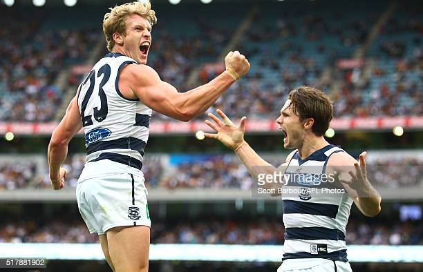 Josh Caddy of the Geelong Cats celebrates after kicking a goal with Patrick Dangerfield of the Geelong Cats during the round one AFL match between...