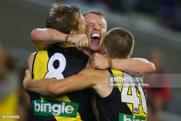 Josh Caddy of the Tigers celebrates a goal in the dying stages to seal victory during the round five AFL match between the Richmond Tigers and the...