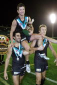Josh Carr of the Power is chaired off by team mates Domenic Cassisi and Dean Brogan after the round 17 AFL match between the Port Adelaide Power and...