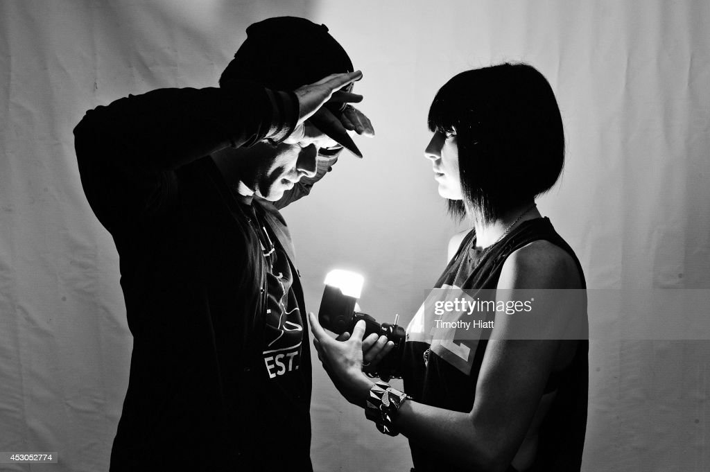 Josh Carter and Sarah Barthel of Phantogram pose for a portrait session at Lollapalooza 2014 at Grant Park on August 1 2014 in Chicago Illinois