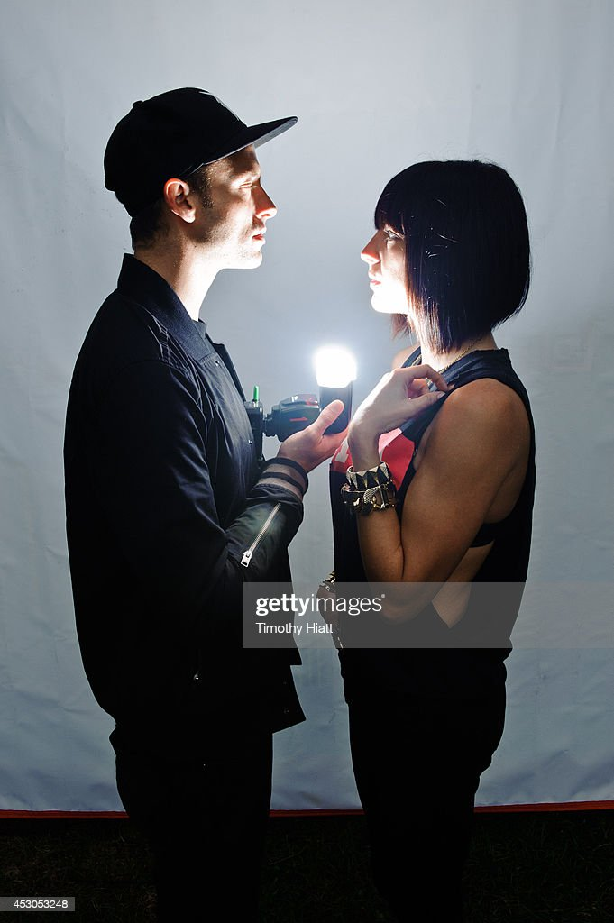 Josh Carter and Sarah Barthel of Phantogram pose for a portrait session during Lollapalooza 2014 at Grant Park on August 1 2014 in Chicago Illinois