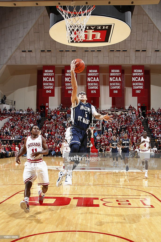 Josh Castellanos #5 of the Mount St. Mary's Mountaineers goes up for shot against the Indiana Hoosiers during the game at Assembly Hall on December 19, 2012 in Bloomington, Indiana. The Hoosiers won 93-54.