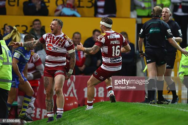 Josh Charnley of Wigan celebrates scoring his sides second try alongside Sam Powell during the First Utility Super League Final between Warrington...