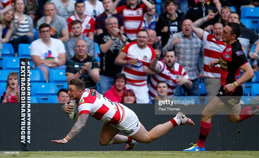 Josh Charnley (L) of Wigan dives into score a try past <a gi-track='captionPersonalityLinkClicked' href=/galleries/search?phrase=Kevin+Sinfield&family=editorial&specificpeople=240224 ng-click='$event.stopPropagation()'>Kevin Sinfield</a> of Leeds during the Super League Magic Weekend match between Leeds Rhinos and Wigan Warriors at the Etihad Stadium on May 26, 2013 in Manchester, England.