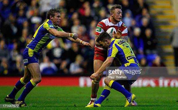 Josh Charnley of Wigan in action Brett Hodgson and Richie Myler of Warrington during the Super League match between Warrington Wolves and Wigan...