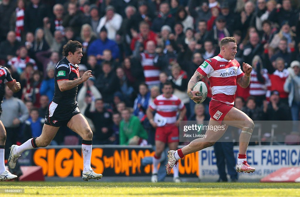 Josh Charnley of Wigan Warriors breaks through to score his try against St Helens during the Super League match between Wigan Warriors and St Helens at DW Stadium on March 29, 2013 in Wigan, England.