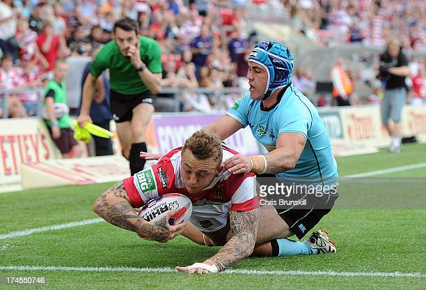 Josh Charnley of Wigan Warriors goes over for a try under pressure from Tommy Lee of London Broncos during the Tetley's Challenge Cup SemiFinal...