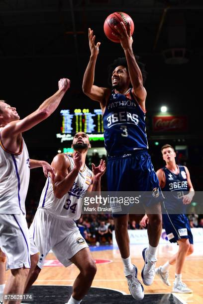 Josh Childress of the 36ers makes a basket past Perry Ellis of the Sydney Kings during the round seven NBL match between Adelaide 36ers and the...