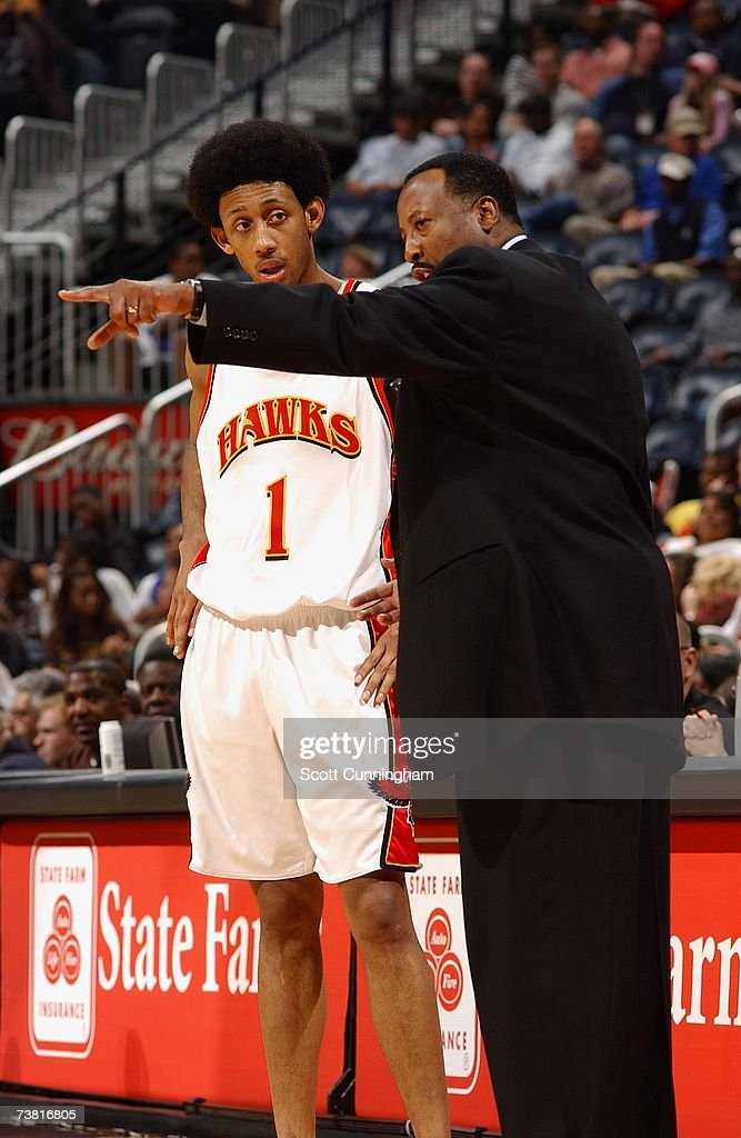 Josh Childress of the Atlanta Hawks talks with head coach Mike Woodson during the game against the Minnesota Timberwolves at Philips Arena on March...