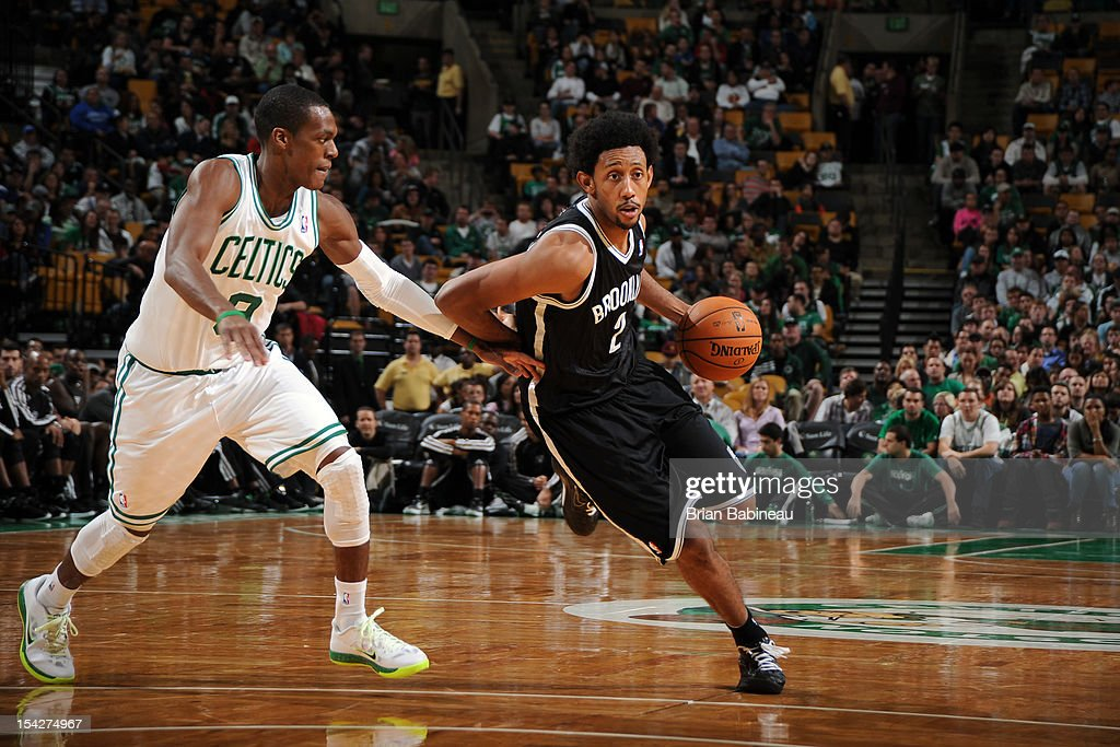 Josh Childress #2 of the Brooklyn Nets handles the ball against <a gi-track='captionPersonalityLinkClicked' href=/galleries/search?phrase=Rajon+Rondo&family=editorial&specificpeople=206983 ng-click='$event.stopPropagation()'>Rajon Rondo</a> #9 of the Boston Celtics on October 16, 2012 at the TD Garden in Boston, Massachusetts.