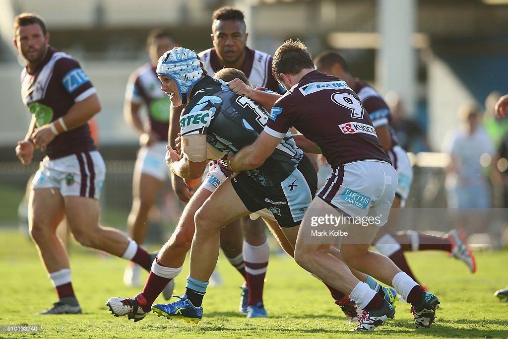 Josh Cleeland of the Sharks is tackled during the NRL Trial match between the Cronulla Sharks and the Manly Sea Eagles at Remondis Stadium on February 14, 2016 in Sydney, Australia.