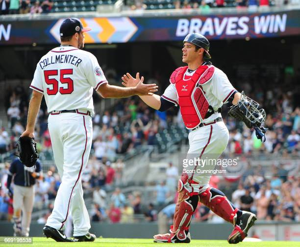 Josh Collmenter and Anthony Recker of the Atlanta Braves celebrate after the game against the San Diego Padres at SunTrust Park on April 16 2017 in...