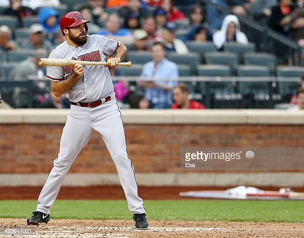 Josh Collmenter of the Arizona Diamondbacks bunts in the second inning against the New York Mets on May 24 2014 at Citi Field in the Flushing...