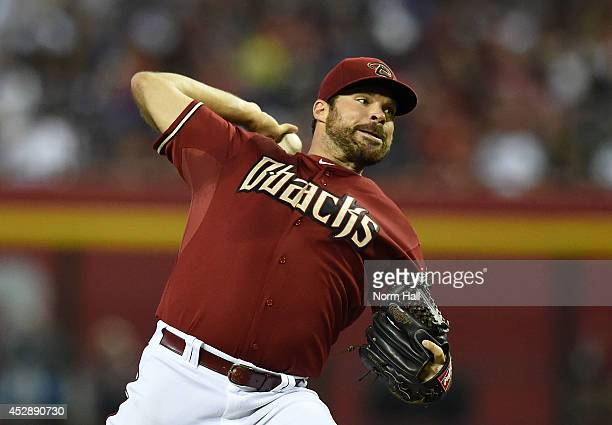 Josh Collmenter of the Arizona Diamondbacks delivers a pitch against the Chicago Cubs at Chase Field on July 20 2014 in Phoenix Arizona