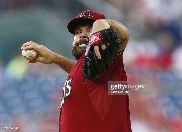 Josh Collmenter of the Arizona Diamondbacks delivers a pitch against the Philadelphia Phillies during the first inning of a game at Citizens Bank...