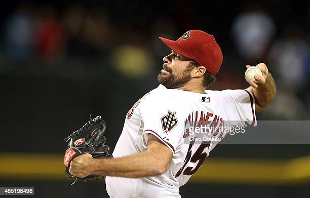 Josh Collmenter of the Arizona Diamondbacks delivers a pitch during the top of the ninth inning of the Major League Baseball game between the Arizona...