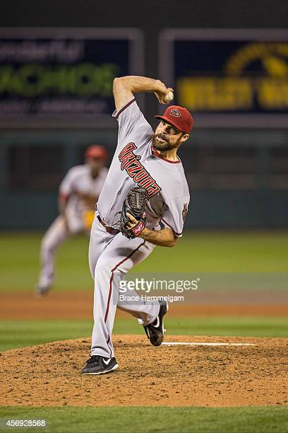 Josh Collmenter of the Arizona Diamondbacks pitches against the Minnesota Twins on September 22 2014 at Target Field in Minneapolis Minnesota The...