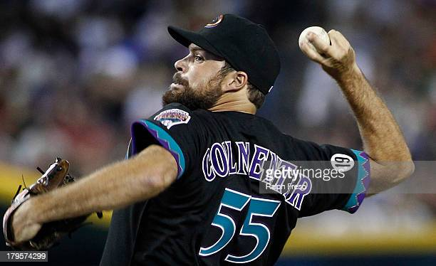 Josh Collmenter of the Arizona Diamondbacks pitches against the San Francisco Giants during the seventh inning of a MLB game at Chase Field on August...