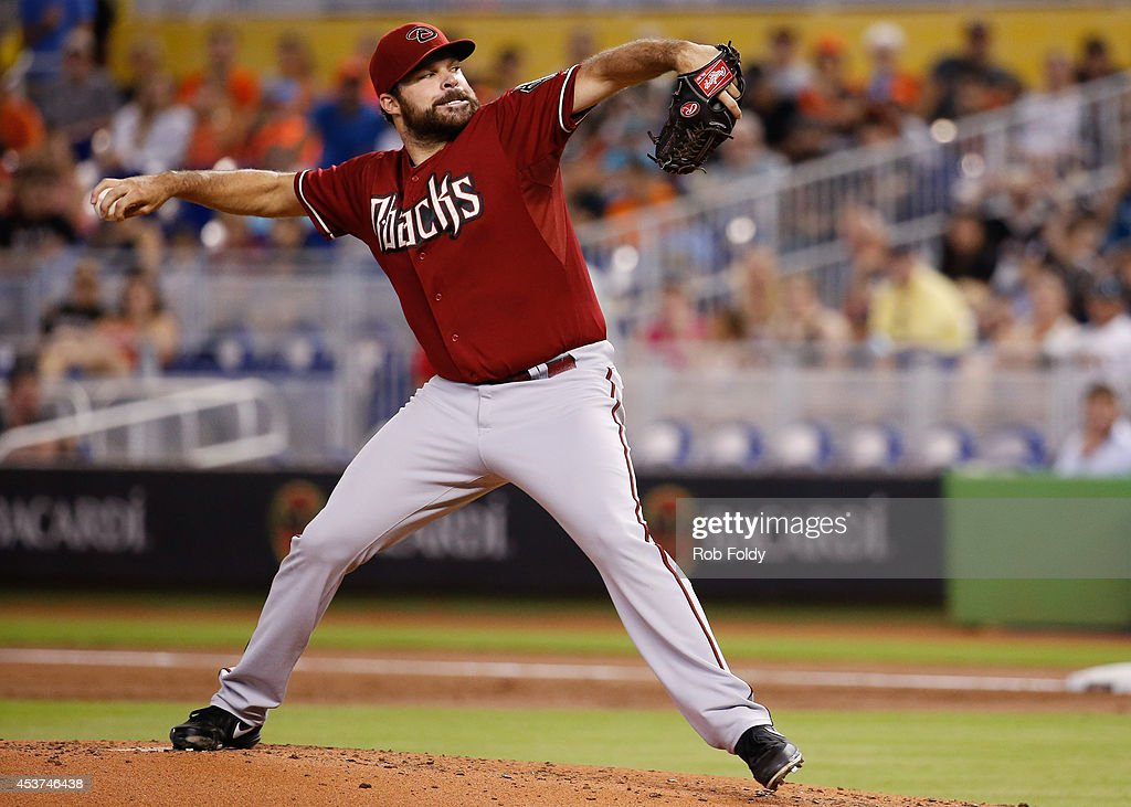<a gi-track='captionPersonalityLinkClicked' href=/galleries/search?phrase=Josh+Collmenter&family=editorial&specificpeople=7510566 ng-click='$event.stopPropagation()'>Josh Collmenter</a> #55 of the Arizona Diamondbacks pitches during the first inning of the game against the Miami Marlins at Marlins Park on August 17, 2014 in Miami, Florida.