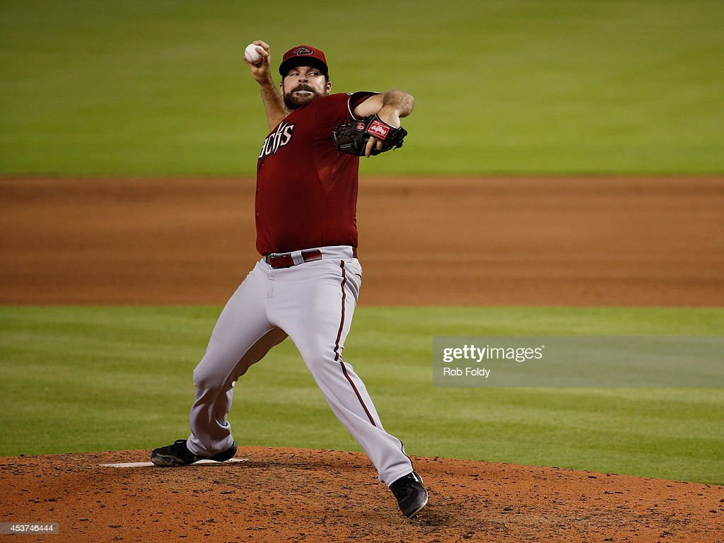 <a gi-track='captionPersonalityLinkClicked' href=/galleries/search?phrase=Josh+Collmenter&family=editorial&specificpeople=7510566 ng-click='$event.stopPropagation()'>Josh Collmenter</a> #55 of the Arizona Diamondbacks pitches during the fourth inning of the game against the Miami Marlins at Marlins Park on August 17, 2014 in Miami, Florida.