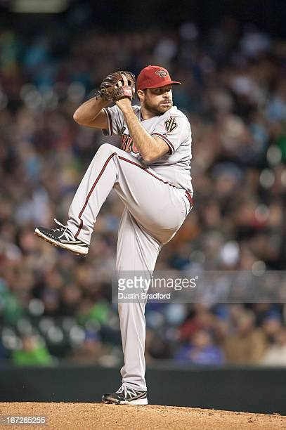 Josh Collmenter of the Arizona Diamondbacks pitches in the eighth inning of a game against the Colorado Rockies at Coors Field on April 20 2013 in...