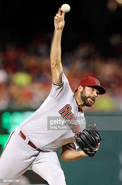 Josh Collmenter of the Arizona Diamondbacks pitches in the second inning against the Washington Nationals at Nationals Park on August 4 2015 in...