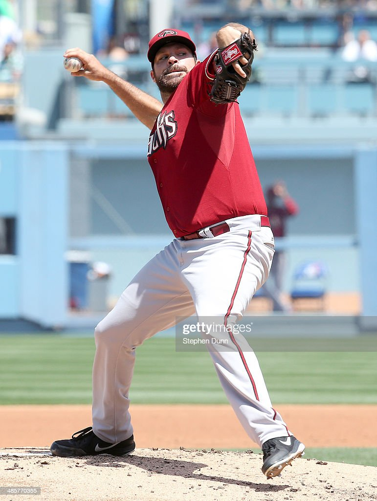 <a gi-track='captionPersonalityLinkClicked' href=/galleries/search?phrase=Josh+Collmenter&family=editorial&specificpeople=7510566 ng-click='$event.stopPropagation()'>Josh Collmenter</a> #55 of the Arizona Diamondbacks throws a pitch against the Los Angeles Dodgers at Dodger Stadium on April 20, 2014 in Los Angeles, California.