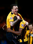 Josh Coulson of Cambridge United celebrates with teammate Tom Elliott after the FA Cup Fourth Round match between Cambridge United and Manchester...