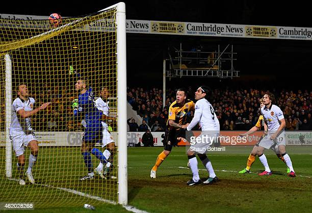 Josh Coulson of Cambridge United heads over the bar during the FA Cup Fourth Round match between Cambridge United and Manchester United at The R...