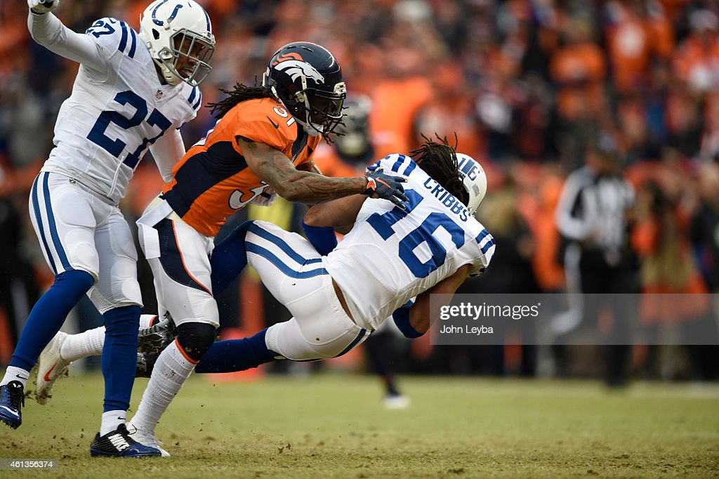 Josh Cribbs of the Indianapolis Colts is hit by Omar Bolden of the Denver Broncos on a punt return in the first quarter The Denver Broncos played the...