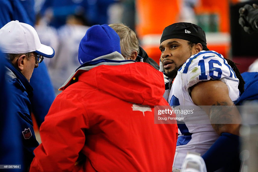 Josh Cribbs of the Indianapolis Colts receives medical attention on the bench during a 2015 AFC Divisional Playoff game against the Denver Broncos at...