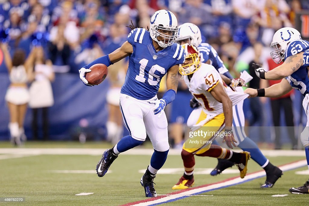 Josh Cribbs of the Indianapolis Colts runs with the ball during the game against the Washington Redskins at Lucas Oil Stadium on November 30 2014 in...