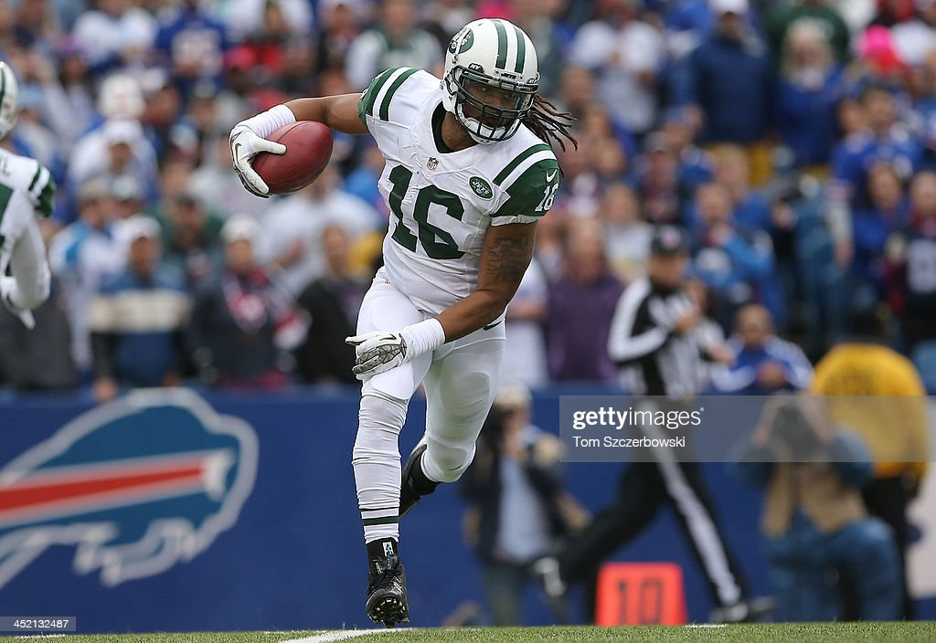 Josh Cribbs of the New York Jets returns a kick during NFL game action against the Buffalo Bills at Ralph Wilson Stadium on November 17 2013 in...