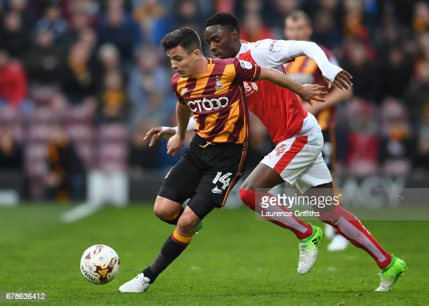 Josh Cullen of Bradford City holds off Devante Cole of Fleetwood Town during the Sky Bet League One playoff semi final first leg match between...