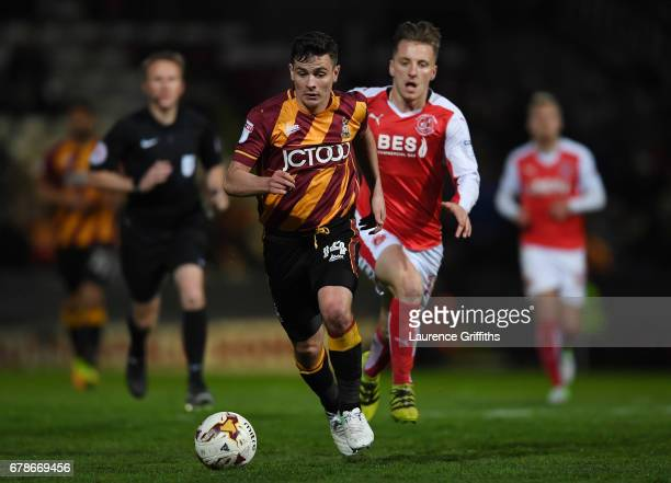 Josh Cullen of Bradford City is chased by Joe Davis of Fleetwood Town during the Sky Bet League One playoff semi final first leg match between...