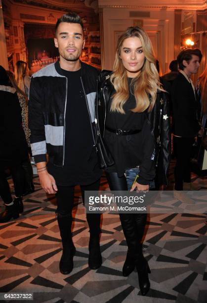 Josh Cuthbert and Chloe Lloyd attend the Aspinal of London Presentation during the London Fashion Week February 2017 collections on February 20 2017...