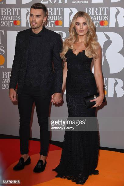 Josh Cuthbert and Chloe Lloyd attend The BRIT Awards 2017 at The O2 Arena on February 22 2017 in London England